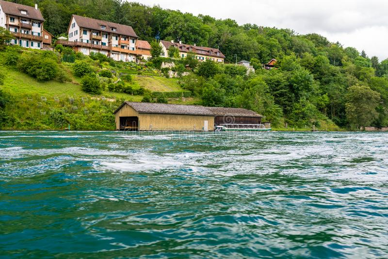 Beautiful view of the Rhine river in turquoise, at the source in Switzerland, just behind the biggest waterfall in Europe. Beautiful view of the Rhine river in stock image