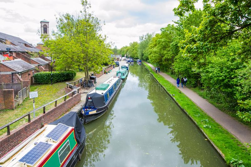 Beautiful view of the river Avon, Bath, England. Green landscape with a lot of trees, river boats and savage nature royalty free stock images