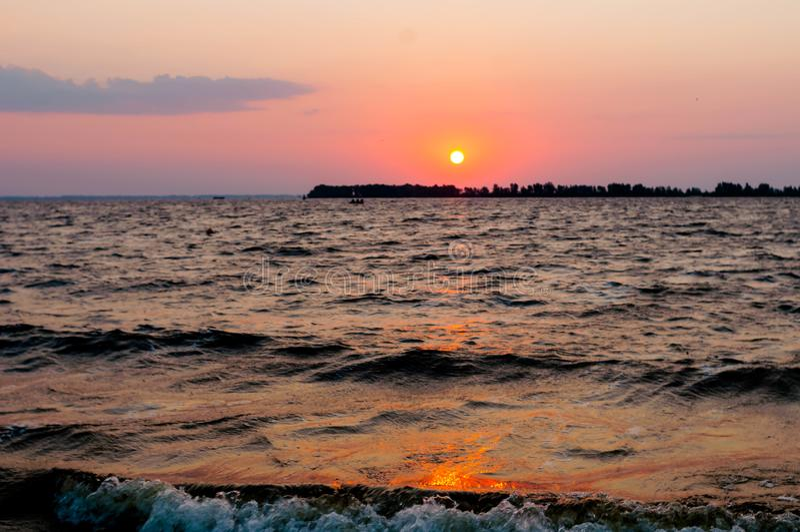 River coast and rising sun at dawn royalty free stock images