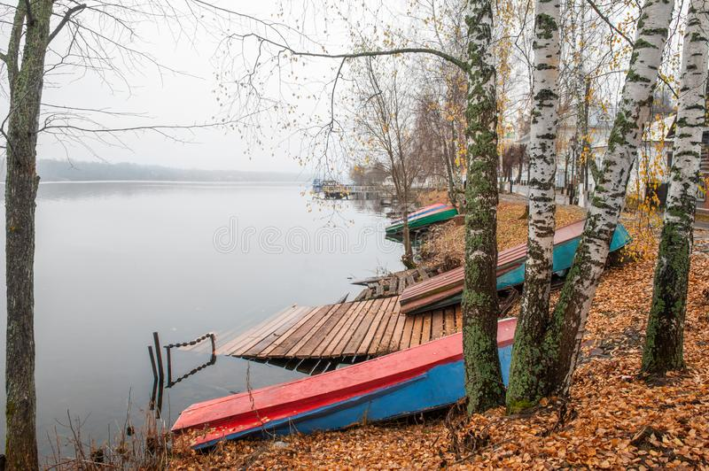 Beautiful view of the river embankment with boats on the shore in late autumn. Ples old Russian city in Russia on the Volga river. Beautiful view of the Volga royalty free stock image