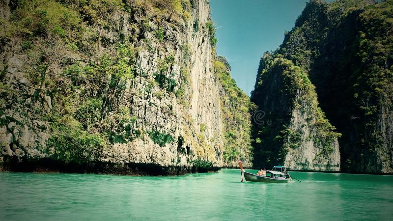 Beautiful view of rocks, sea and boat on an island in thailand Phuket. Travel stock images