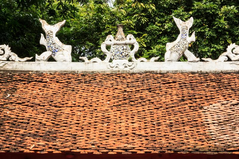 Beautiful View of Roof Sculptures Art of Temple of Literature Van Mieu in Vietnamese, it known as Temple of Confucius in Hanoi. royalty free stock image
