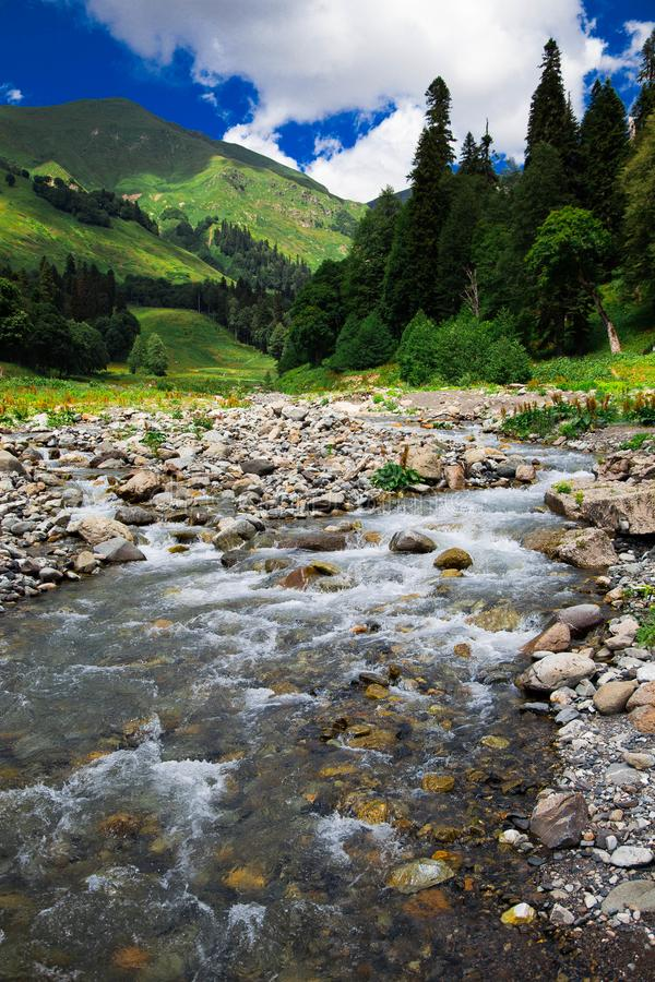 The river is high in the mountains royalty free stock image