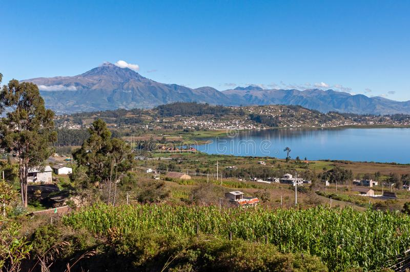 View of the San Pablo lake and Cotacachi volcano, Ecuador. Beautiful view of the San Pablo lake, with surrounding houses and towns, and the Cotacachi volcano in royalty free stock photography
