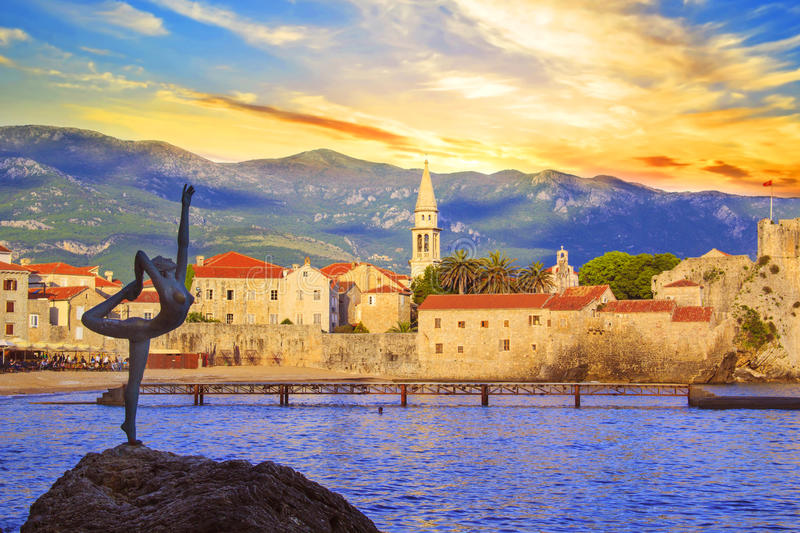 Beautiful view of the sculpture Ballerina Dancer of Budva at sunset, Montenegro stock images