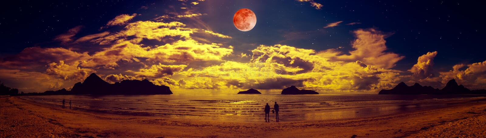 Colorful blue sky with cloud and bright full moon on seascape to night royalty free stock photography