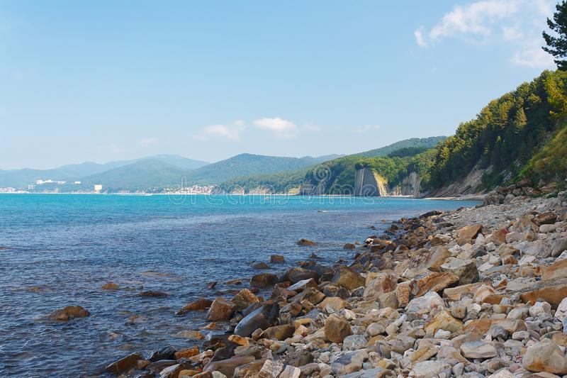 Beautiful view of the sea and forested mountain beach stock photography