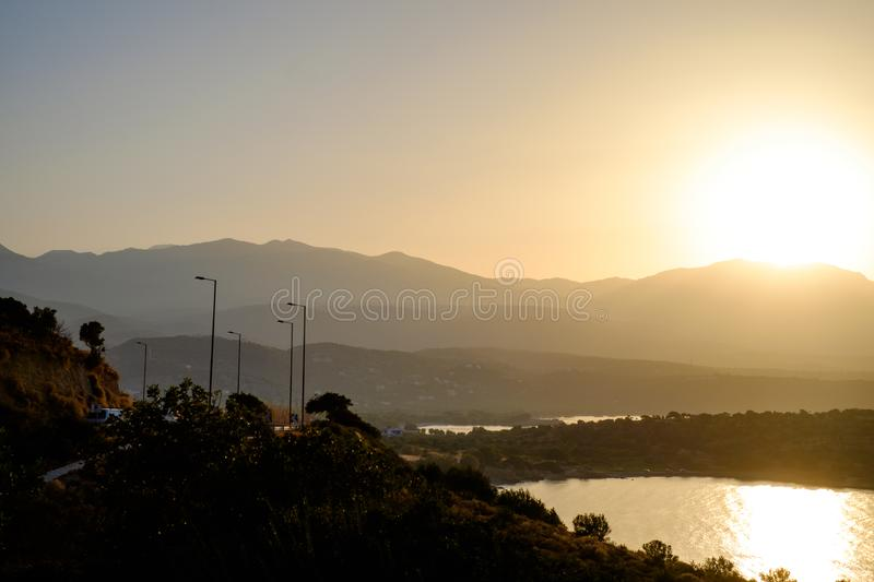 Beautiful views of the sea and mountains. Sunset royalty free stock photography