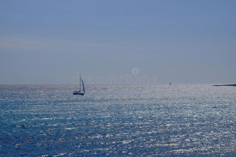 Beautiful view on the sea and sailboat on Menorca,  Balearic Islands. Beautiful view on the sea and sailboat on the Balearic Island Menorca, Spain, beach, son stock photography
