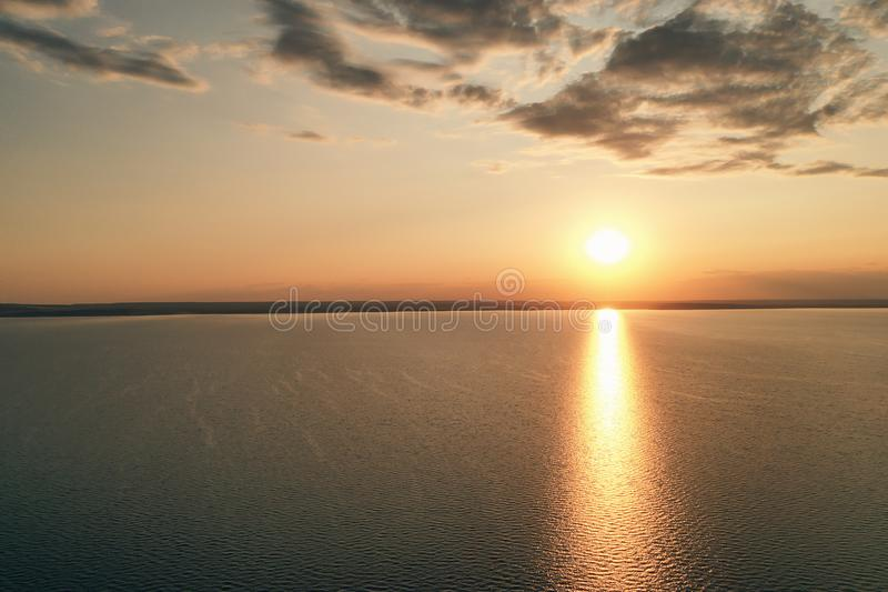 Beautiful view of the sea and sunset. Aerial view from flying drone of a beautiful nature landscape with dramatic clouds sunset sk royalty free stock photos