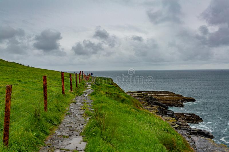 Beautiful view of the sea and a trail from Doolin to the Cliffs of Moher royalty free stock photos