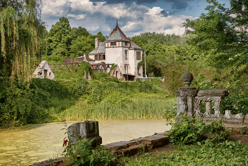 Beautiful view of Sharovsky Castle building in park with lake royalty free stock image