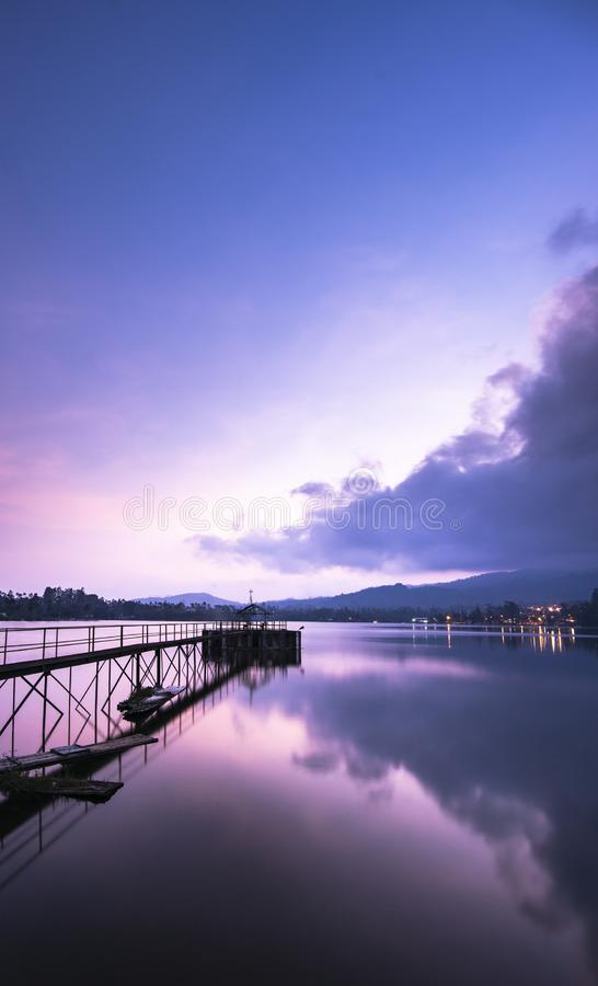 Beautiful view shortly after sunset. On a lake with colourful clouds skies stock images