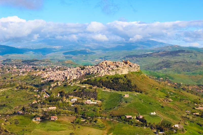 Beautiful view of Sicilian village Calascibetta taken with adjacent mountains and green landscape. The historical Arab city royalty free stock images