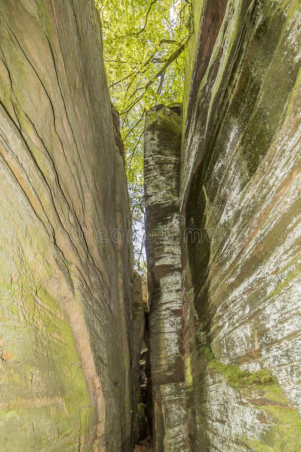 View of a slot between two rock walls stone stock photos