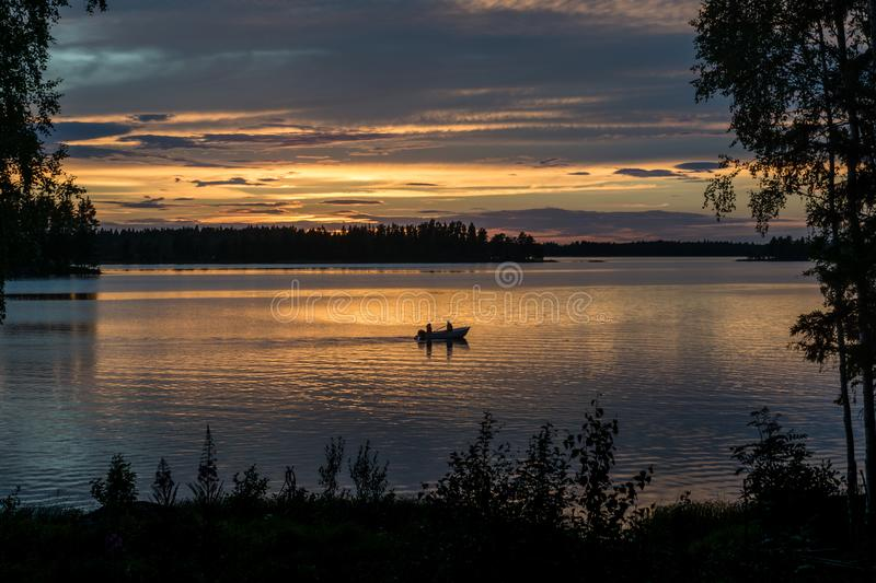 Beautiful view of a small fishing boat in sunset royalty free stock photography