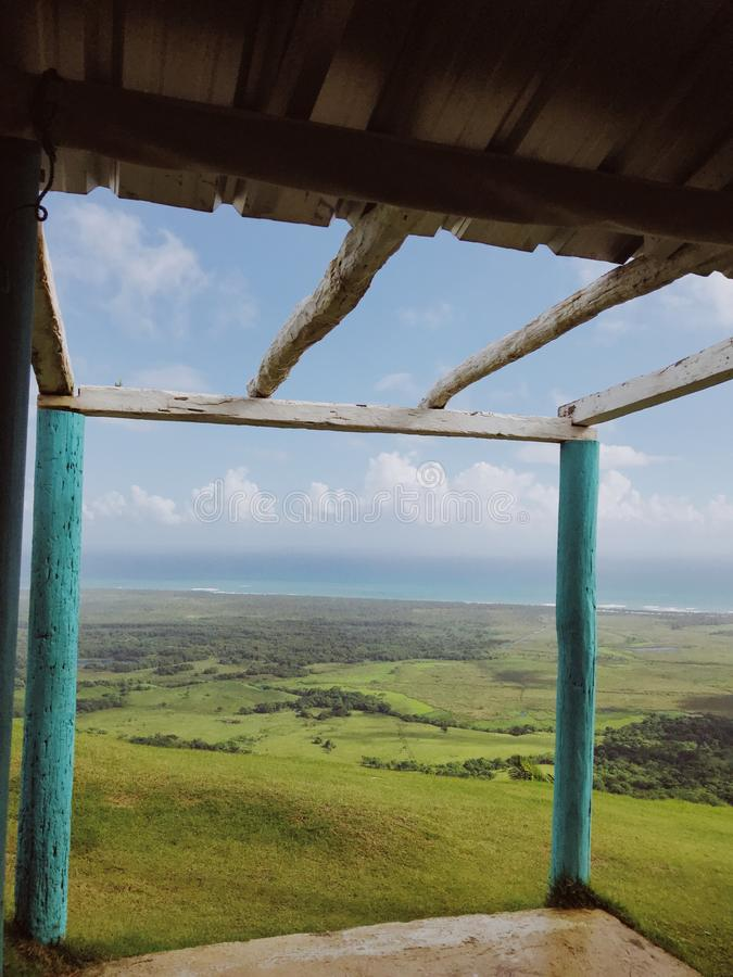 Beautiful view from the small hut. On the Redonda Mountain and green hills of Dominican Republic and the Atlantic Ocean stock images