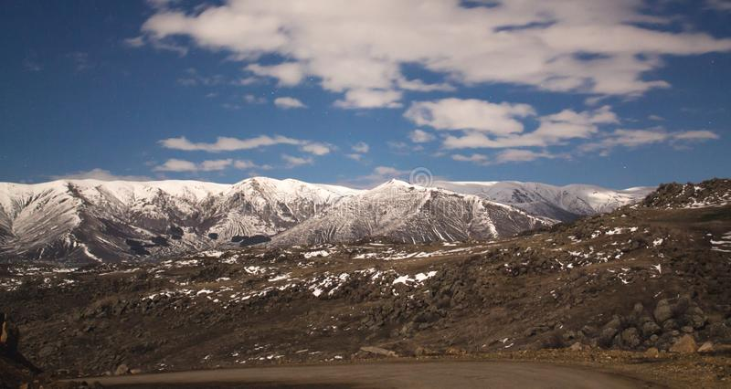 Beautiful view. Snowy mountain with clouds royalty free stock images