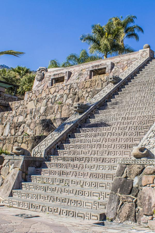 Beautiful view of a stone staircase with mayan decoration. On a wonderful and sunny day with an intense blue sky in Chapala Jalisco Mexico royalty free stock photos