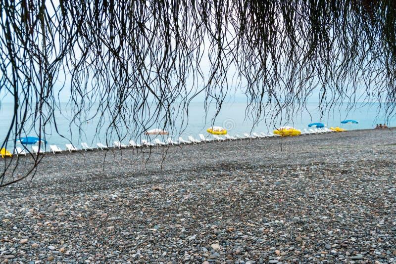 Beautiful view of the stony beach in kvariati, Adjara. deck chairs on the beach. Travel stock image