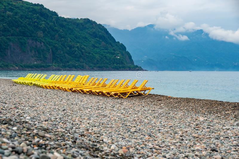 Beautiful view of the stony beach in kvariati, Adjara. deck chairs on the beach. Travel royalty free stock photo