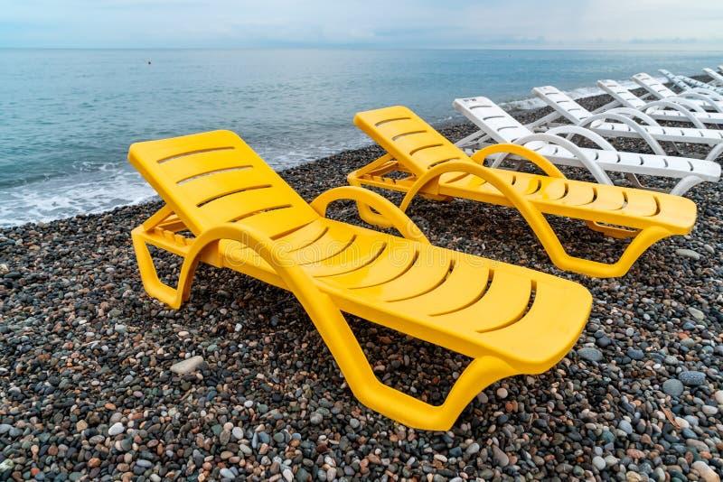 Beautiful view of the stony beach in kvariati, Adjara. deck chairs on the beach. Travel royalty free stock image