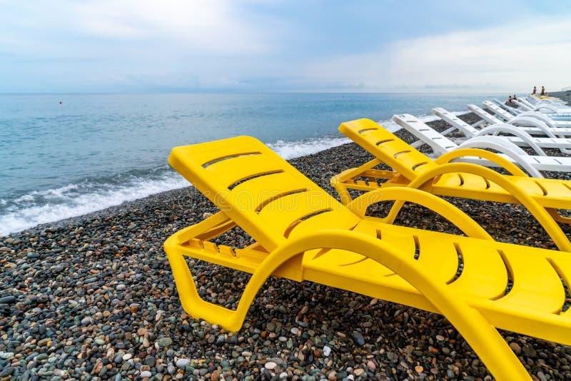 Beautiful view of the stony beach in kvariati, Adjara. deck chairs on the beach. Travel stock photo