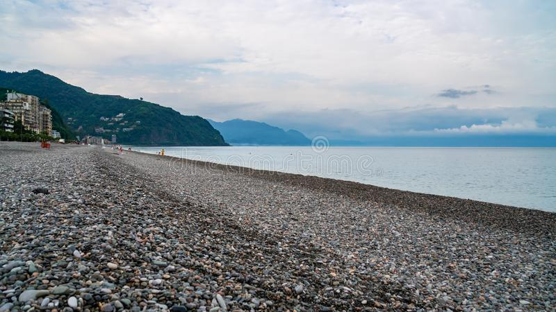 Beautiful view of the stony beach in kvariati, Adjara. deck chairs on the beach. Travel stock images