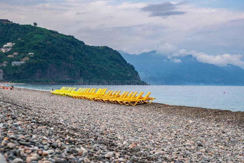 Beautiful view of the stony beach in kvariati, Adjara. deck chairs on the beach. Travel royalty free stock images