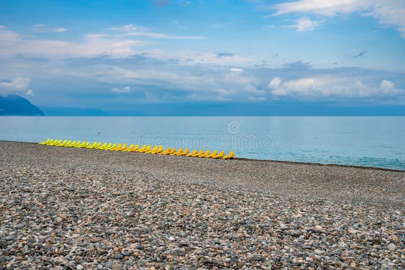 Beautiful view of the stony beach in kvariati, Adjara. deck chairs on the beach. Travel stock photos
