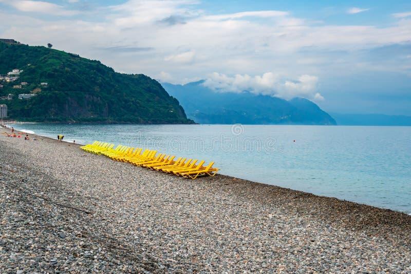 Beautiful view of the stony beach in kvariati, Adjara. deck chairs on the beach. Travel royalty free stock photos