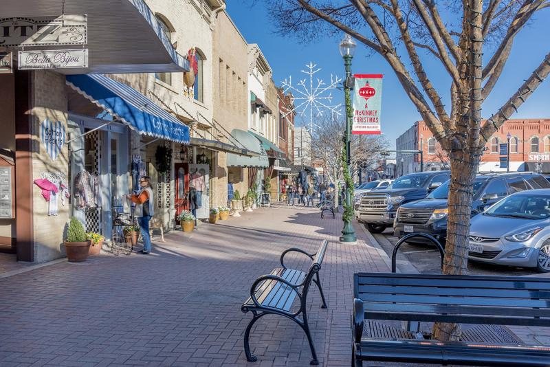 Beautiful view of the stores by a sidewalk captured in McKinney, Texas, United States. MCKINNEY, TEXAS, UNITED STATES - Dec 28, 2018: A beautiful view of the royalty free stock photography