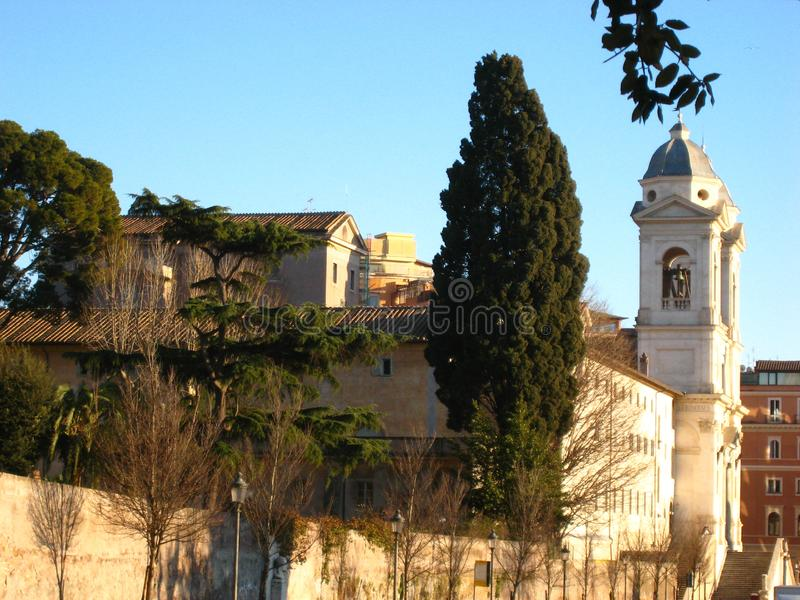 Beautiful view in sunny spring weather in rome with pine trees and charming old buildings stock photography