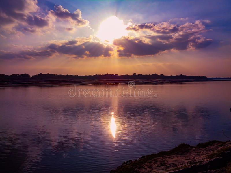 Beautiful view of the sunset in the calm river water. River Sunset Images, Stock Photos stock photos