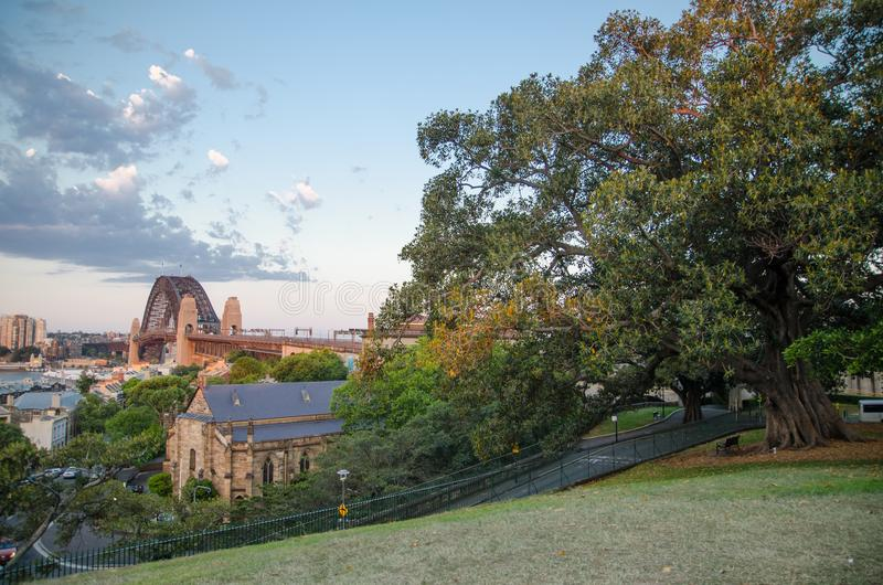 Beautiful view of Sydney Harbour bridge from Observatory Hill Lookout with parkland. SYDNEY, AUSTRALIA. – Beautiful view of Sydney Harbour bridge from stock photo