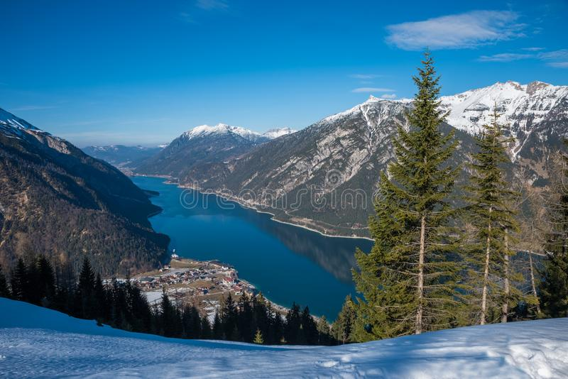 Beautiful view to lake achensee and pertisau, winter landscape austria tirol. blue sky with copy space royalty free stock images