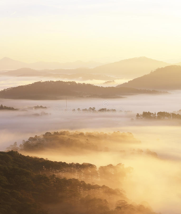 Beautiful view from the top of mountain with mist & fog. Beautiful view from the top of mountain early in morning with mist & fog down in valley royalty free stock photography