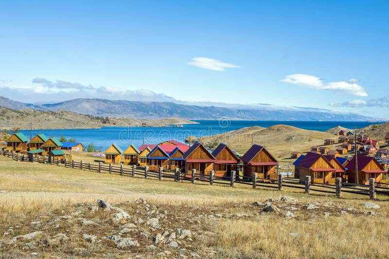 Beautiful view of the tourist centers and Kurkut Bay of Lake Baikal in September. Siberia, Russia stock images