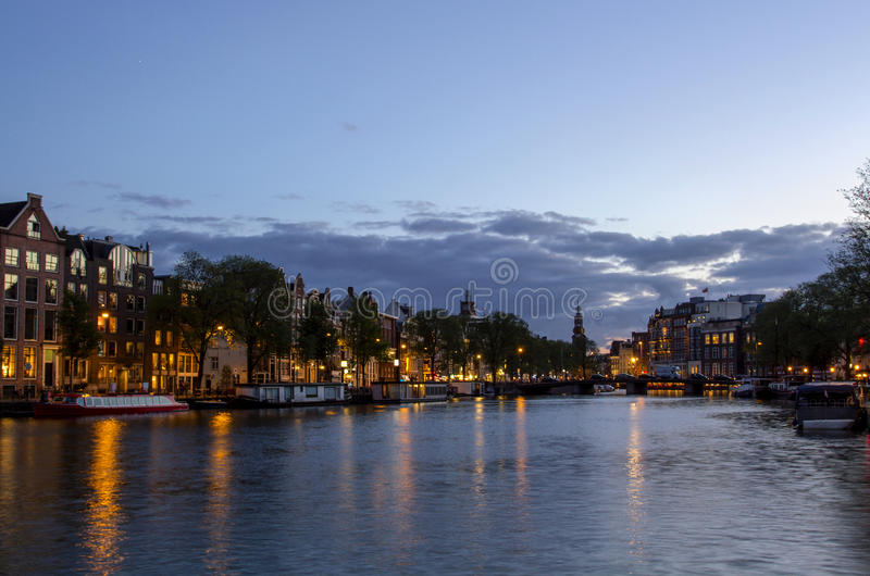 Beautiful view towards at the Amstel river in Amsterdam, the Netherlands.Amsterdam in twilight. stock image
