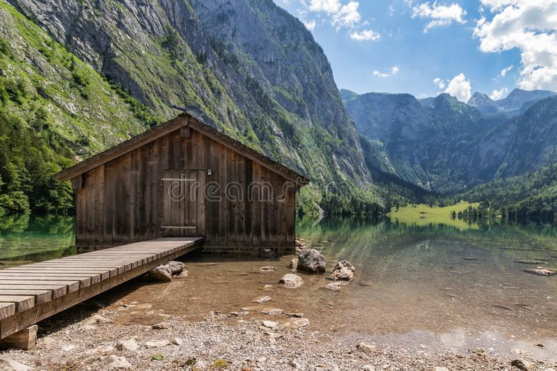 Beautiful view of traditional wooden boat house at the shores of famous Lake Obersee in scenic Nationalpark Berchtesgadener Land o royalty free stock images