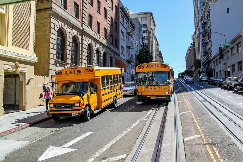 Beautiful view of two yellow school busses on street of San Francisco. Beautiful nature landscape backgrounds. royalty free stock photography