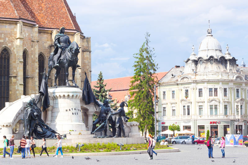 Beautiful view at Union Square, Cluj-Napoca. CLUJ-NAPOCA, ROMANIA - MAY 20, 2014: Piata Unurii (Union Square) with St. Michael's Church and the statue of King of royalty free stock photography