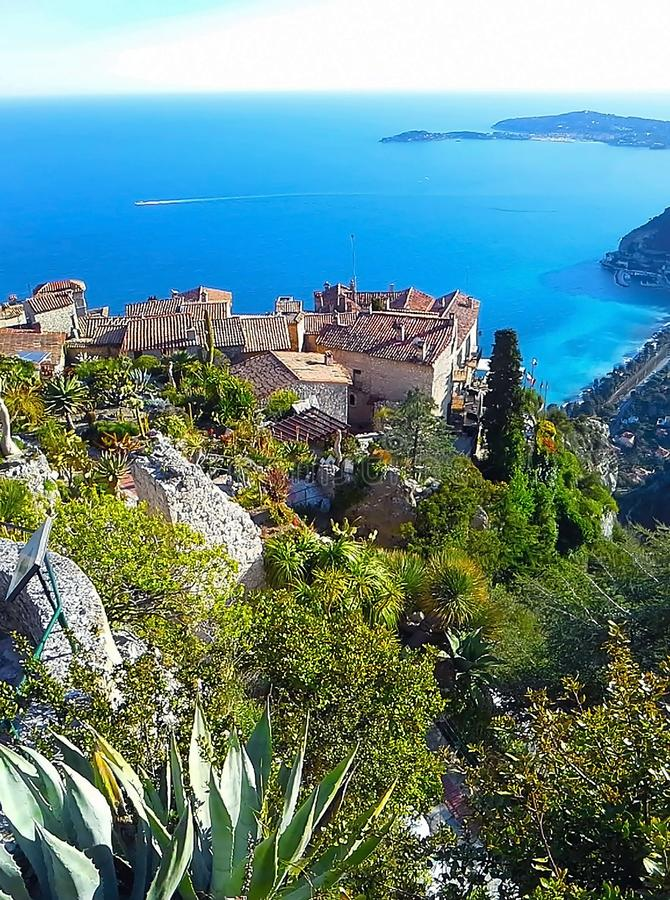 Beautiful view of the village of Eze, a botanical garden with cacti, aloe. Mediterranean, French Riviera, Cote d`Azur, France royalty free stock photos
