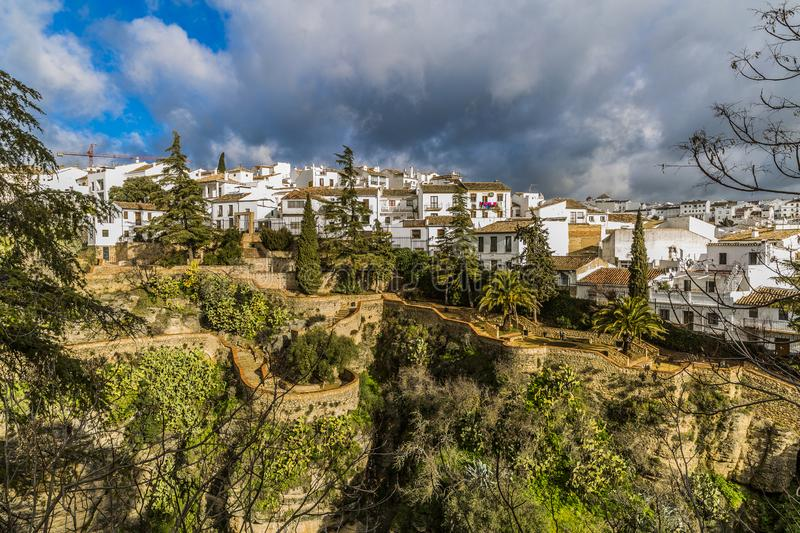 Beautiful view of the village of Ronda with its white houses on the top mountain stock photography