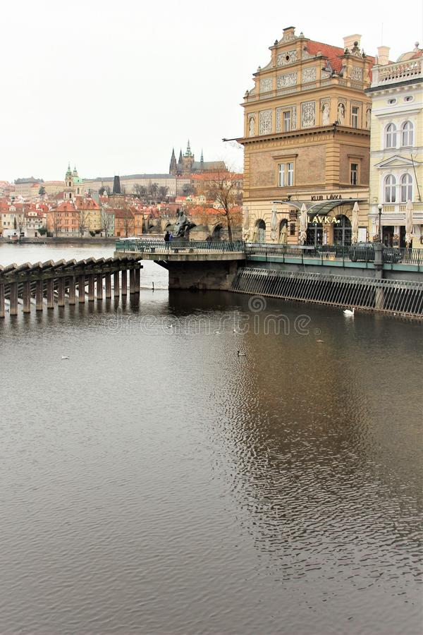 Prague, Czech Republic, January 2013. View of the river, the old town and the monument to the Czech composer Smetana. stock image