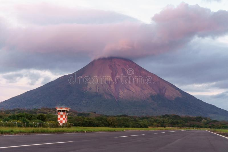 Beautiful view of the volcano on Ometepe island, pink sunset royalty free stock photography