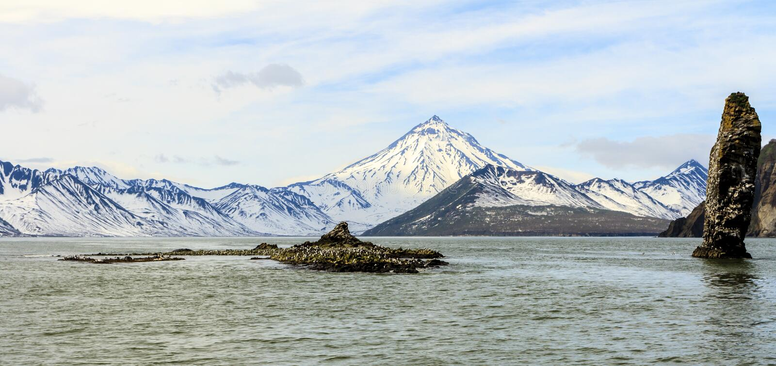 Beautiful view of the volcano Vilyuchinsky from ocean, Kamchatka Peninsula, Russia royalty free stock images