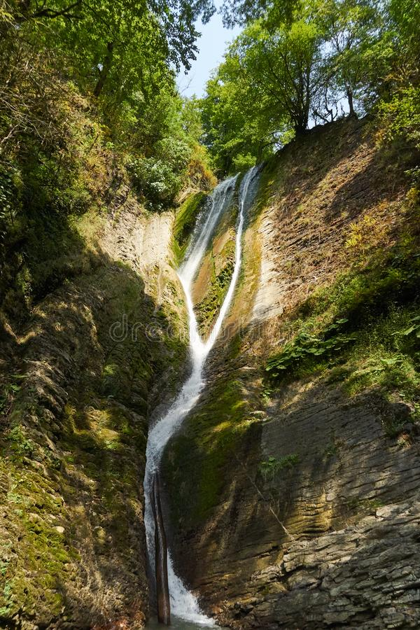 Beautiful view of waterfall landscape. Small waterfall in deep green forest scenery. Sochi, Russia royalty free stock photography