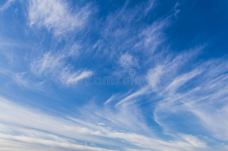 Beautiful view of white colored clouds with a blue sky royalty free stock photo