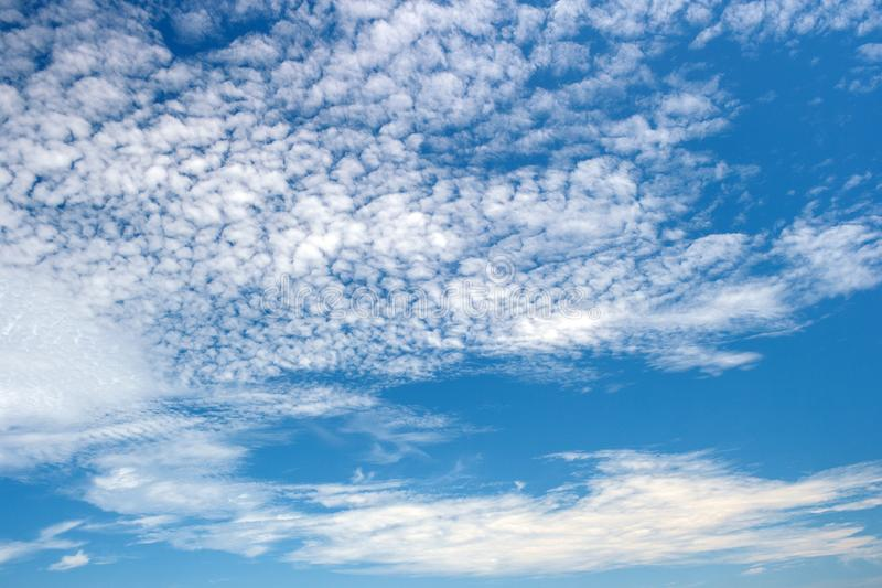 Beautiful view of white fluffy clouds on a clear blue sky background. Nature weather on the vast cloud blue sky. Sky daylight in s. Ummer. Natural background stock images